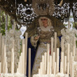 Stock Photo: Front with candles, embroidered fabric and flowers of throne of NuestrSeñordel Amor Hermoso