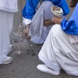 Several altar boys burn incense in a procession of Easter — Stock Photo