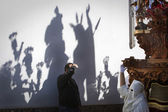 Shadow on a wall of a throne during a Holy week procession — Stock Photo
