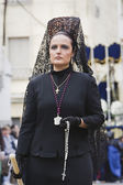Woman dressed in mantilla during a procession of holy week — Stock Photo