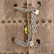 Door closed with chains — Stock Photo