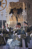 Young people in procession with incense burners and processional candlesticks in Holy week — Stock Photo
