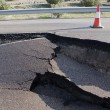 Stock Photo: Asphalt road with crack caused by landslides