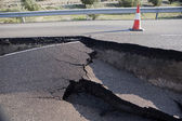 Asphalt road with a crack caused by landslides — Stock Photo