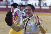 The Spanish Bullfighter Curro jimenez to the turning of honour with an ear in his hand — Zdjęcie stockowe