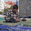 Sailor fixed their fishing nets in the port of Estepona — Stock Photo