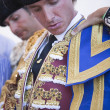 Stock Photo: Spanish bullfighter Jose Luis Moreno getting dressed for paseillo or initial parade