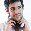 Stock Photo: Young man listening to music with headphones