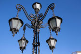 A wrought iron lamp on a weathered wall in First of May Square, Ubeda — Stok fotoğraf
