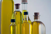 Bottles of extra virgin olive oil — Stock Photo