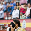 Bullfighter praying with his montera — Stock Photo #34509271