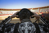 Bullfighter by contacting the montera during a bullfight — Stock Photo