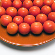 Cherry tomatoes on a ceramic bowl — Stock Photo