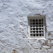 Little window on a whitewashed wall — Stock Photo