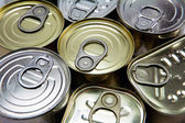 Tins of different sizes and opening — Stock Photo
