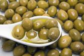 Green olives in a white bucket — Zdjęcie stockowe