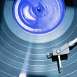 Vintage record player with spinning vinyl — Stock Photo
