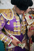 Bullfighters getting dressed for the paseillo or initial parade — Stock Photo
