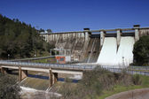 Expulsion of water after heavy rains in the embalse de Puente Nuevo — Stock Photo