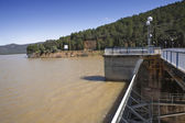 Expulsion of water after heavy rains in the reservoir of Puente Nuevo to river Guadiato, near Cordoba — Stock Photo