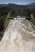Expulsion of water after heavy rains in the embalse de Puente Nuevo to Guadiato river — Stock Photo