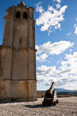 Canon and bell tower of Abbey church — Stock Photo