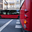 Crossing of urban buses in opposite directions from Gran via — Stock Photo
