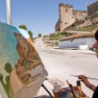 Woman painting on canvas near the castle of Sabiote — Stok fotoğraf