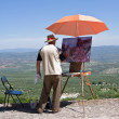 Foto Stock: Mpainting on canvas near castle of Sabiote