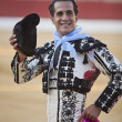 Bullfighter Ivan Fandiño to the turning of honour with montera hat in his hand in the Bullring of Baeza — Stock Photo