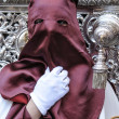 Nazarene that goes with the hand on the manigueta the throne in a procession of holy week — Stock Photo #36523847