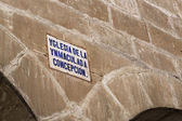 Detail architectural and sign of the street name written in old Castilian — Stock Photo