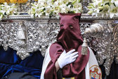 Nazarene that goes with the hand on the manigueta the throne in a procession of holy week — Stock Photo