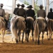 Group of horsemen riding on their backs after dressage exhibition denim in Andujar — Stock Photo