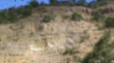 View of passing landscape from a train window after a rain intensively — Stock Video