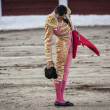 Постер, плакат: Spanish bullfighter Manuel Jesus El Cid drops his hat on the ground