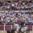 Spanish bullfighter Fermin Bohorquez bullfighting in front of the brave bull with its horse, the public is looking attentively at the toreador in Ubeda — Stock Photo #38653473