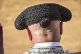 Detail of Bullfighter bald and slightly fat looking the bull dur — Foto de Stock
