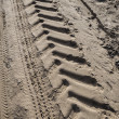 Tractor tire tracks on beach sand — Stock Photo #38965329