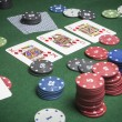 Cards poker deck English, Poker game interesting with a possible winning combination on green background — Stock Photo #39311575