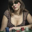 Attractive woman subject his sunglasses while playing a game of poker — Stock Photo