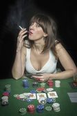 Very beautiful woman playing texas hold'em poker — Zdjęcie stockowe
