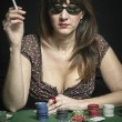 Stock Photo: Attractive womplaying game of poker
