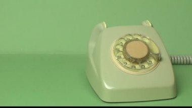 Male hand on very old telephone on green background — Stock Video
