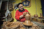 Potter making a water jug in classic mud — Stock Photo