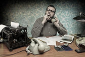 Secretary smoking a cigarette while talking on the phone, 1960's scene — Stock Photo