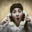 Stock Photo: Young Secretary screams by phone busy vintage