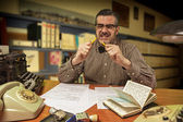 Angry office worker breaks yellow pencil in the office in the 1960s — Stock Photo