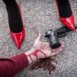 Stock Photo: Mis dominated by womwith red shoes