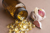 Garlic oil capsules, vitamins d pills  — Stock Photo